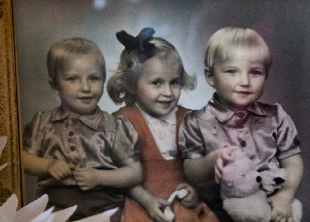 The oldest daughter that passed away only 4 years old, with my dad (right) and his twin.